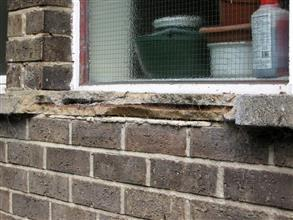 Damaged window sills due to corrosion of reinforcement bars